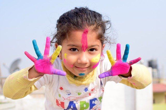 Happy girl with painted hands